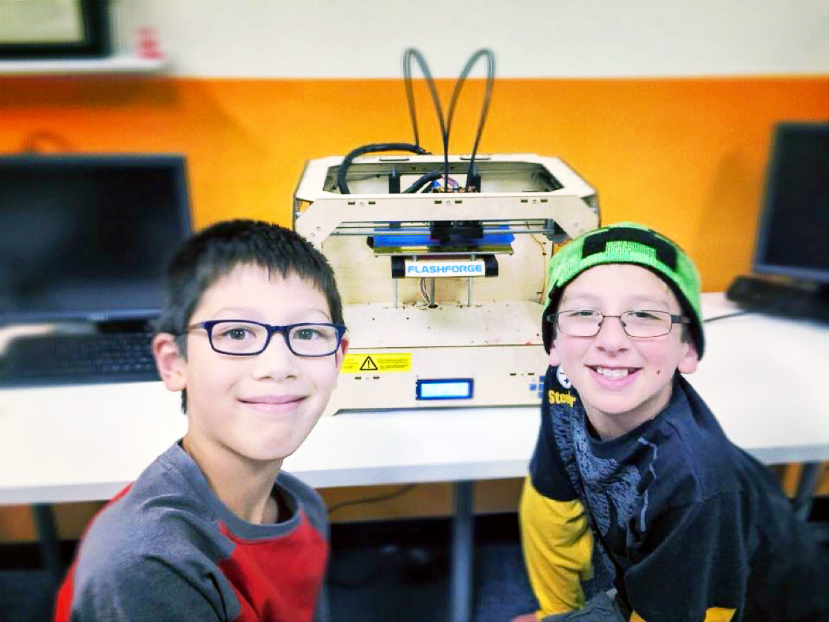 Kids lean how to print in 3D (3 dimensions)